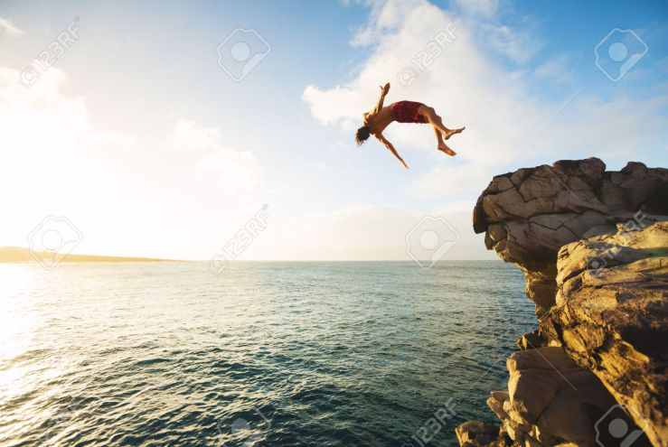 Cliff-Jumping-into-the-Ocean-at-Sunset-Outdoor-Adventure-Lifestyle-Stock-Photo